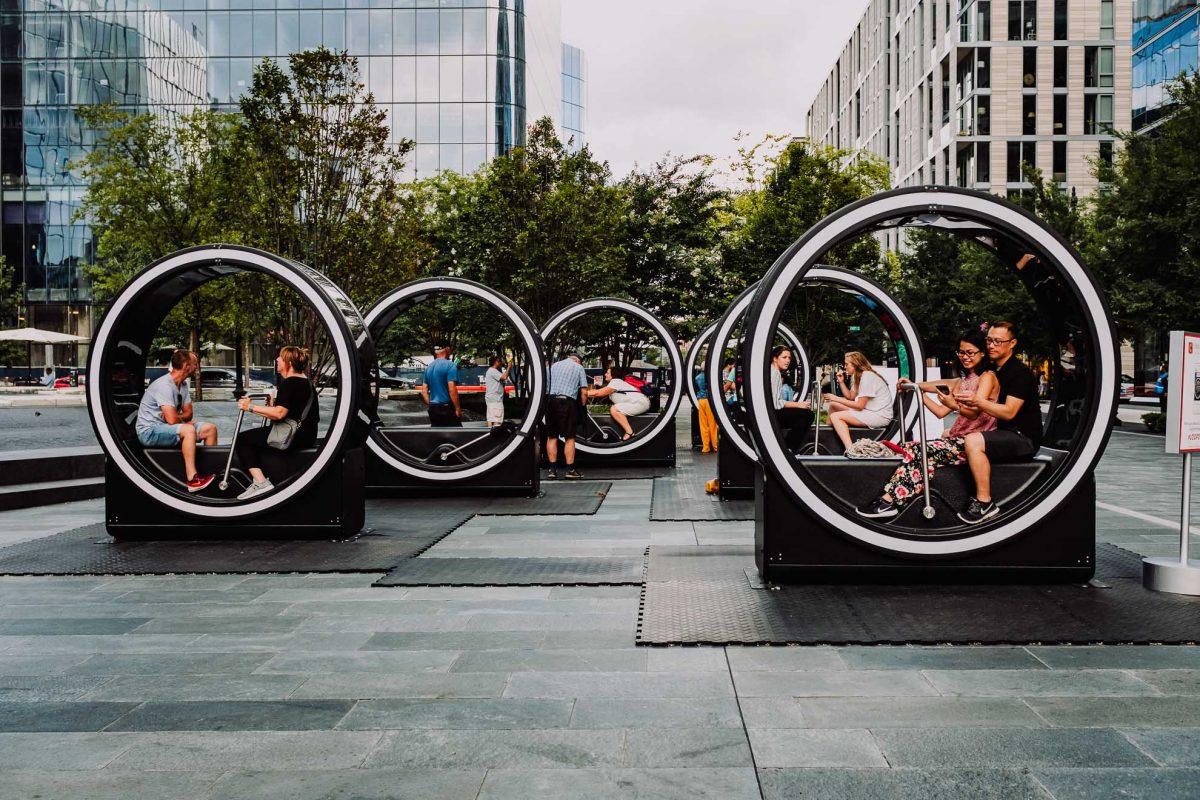 Street photo of people enjoying the loop art installation at City Center, Washington DC