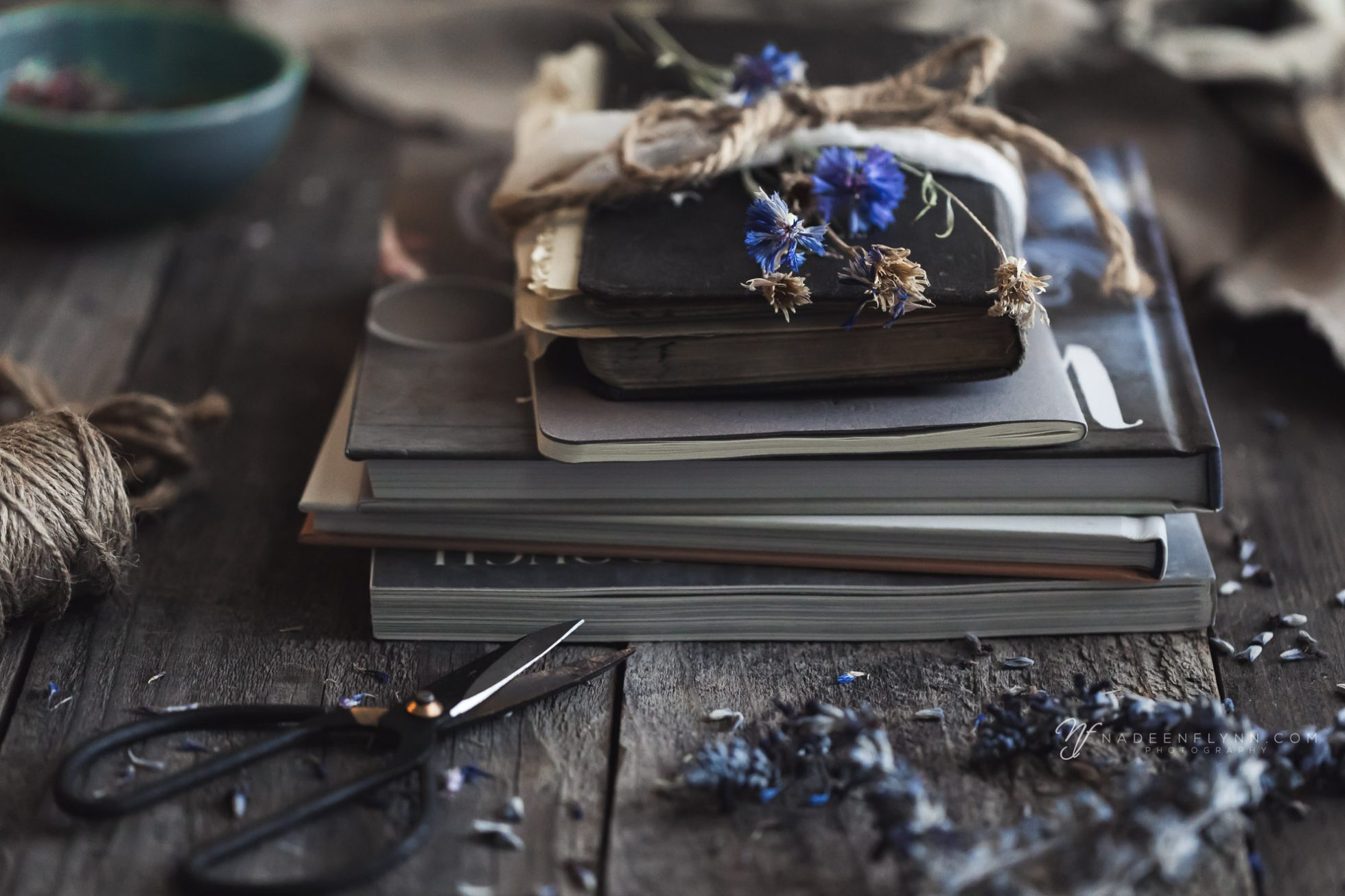 book projects with dried Bachelor Buttons, scissors, twine