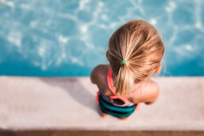 Little girl anticipating getting in the pool.