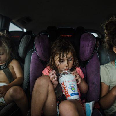 children-summer-sonic-drive-thru-carseats-siblings-messy-ice-cream