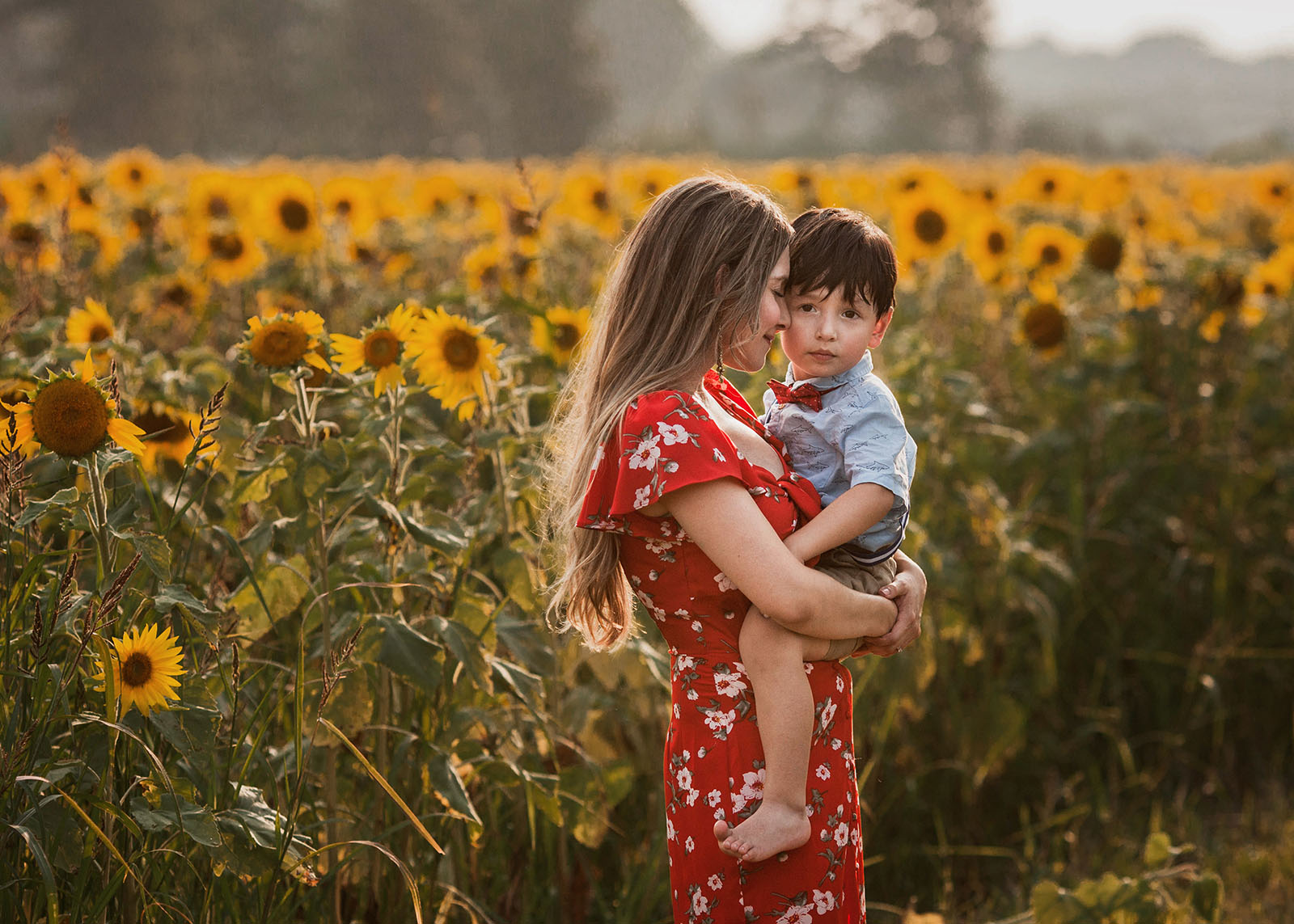 Mommy and me session taken at sunflower field in Cleveland Ohio by top Cleveland photographer Chelsey Hill Photography