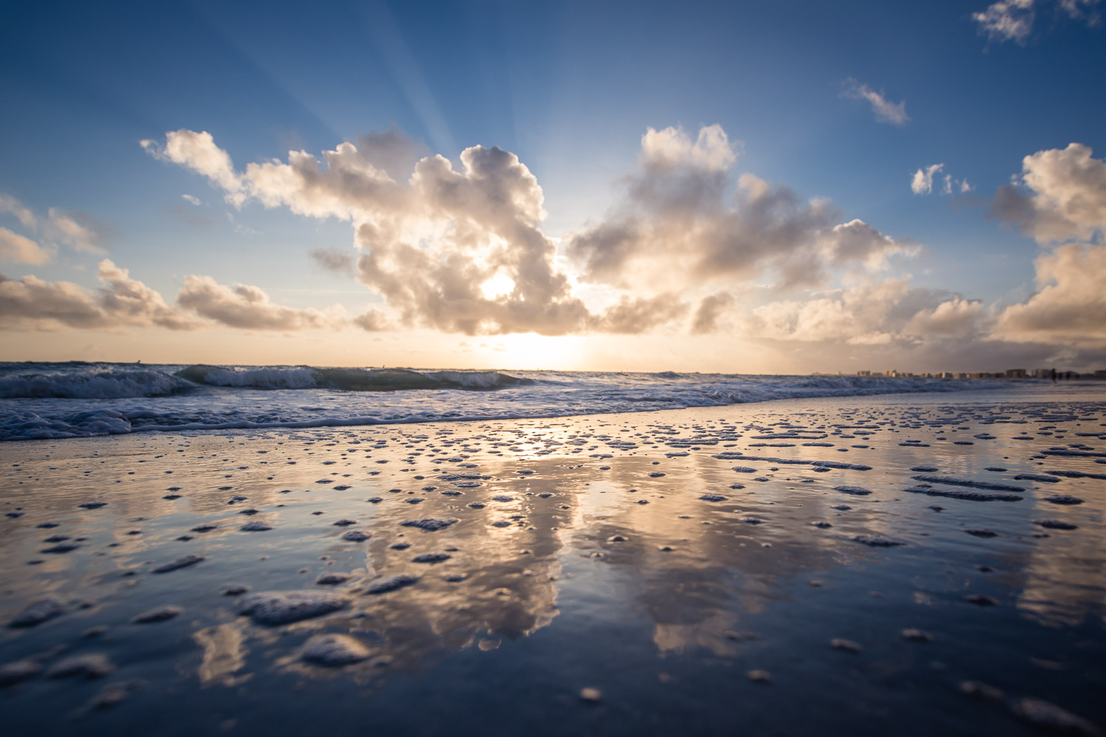 Florida beach sunset with cloud reflection