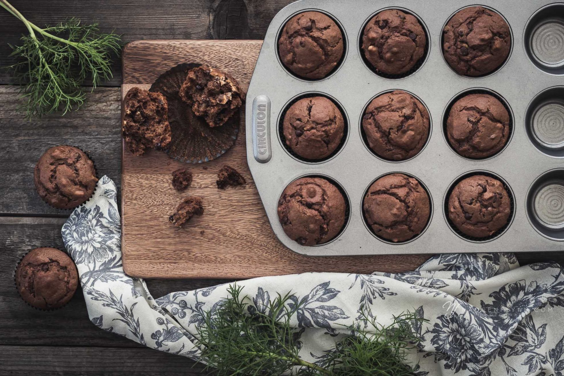 muffin time with chocolate muffins in tin with floral linen napkin