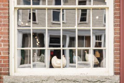 Simon Pearce Window display of ceramic hens in Vermont