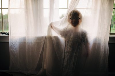 jack-the-friendly-ghost-toddler-in-sheer-curtain