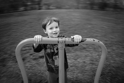 Boy on Merry go round in black and white