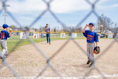 T-ball shooting through chain link fence