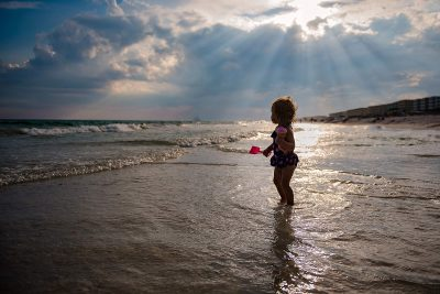 Girl at beach with sun beams