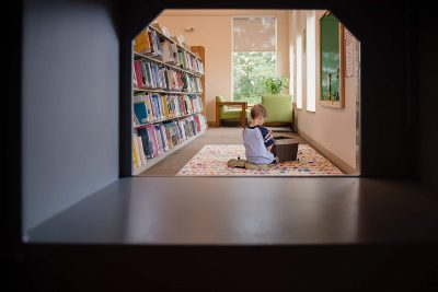 Boy in library framed