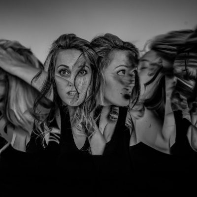 Several images of the same woman created though in camera multiple exposure
