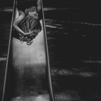 A self portrait with a different perspective using a playground slide