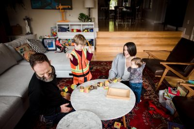 A family in their edmonton living room during a casual family photo session