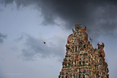 A storm brews around the gopuram of the Meenakshi Amman Temple in Madurai, Tamil Nadu, India