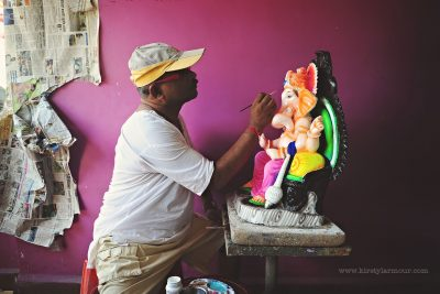 An artist paints a Ganesha idol statue in preparation for the Ganesh Chaturthi festival in God, India, by Kirsty Larmour