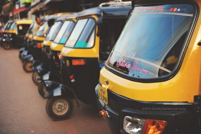 A row of Autorickshaws lined up at a stand in India