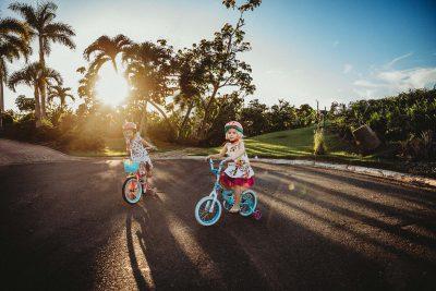girls-bike-riding-cul-de-sac-sunset-light-lifestyle-photography