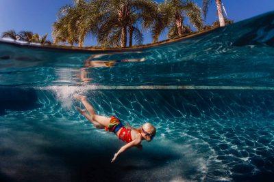 girl-swimming-underwater-photography-palm-trees-jenna-sefkow