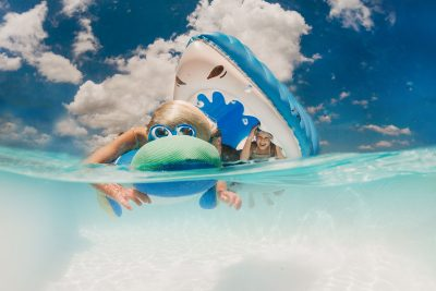 Girl chases sister in shark float underwater photography go pro pool big mouth inc