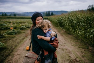 Mama and her baby boy snuggling at the pumpkin patch at Remlinger Farms in Carnation Washington.