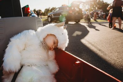 Baby boy in goat costume falls asleep in wagon while trick or treating