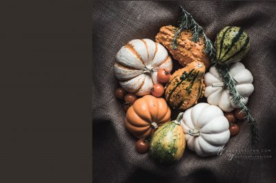 assorted gourds on a nest of burlap