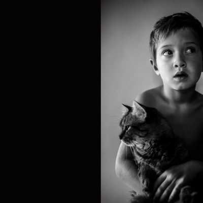 little boy holding cat