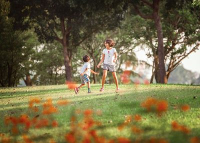 kids playing in a filed