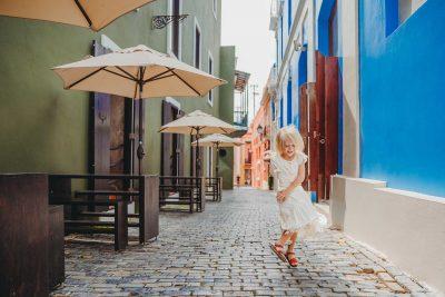 girl-skips-street-cobblestone-old-san-juan-Snapberry-photographs