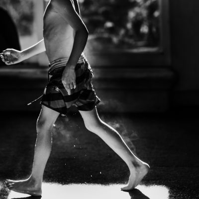 smoking boy after spa walking patch light indoor pool annick simon paradis photographe famille family documentary