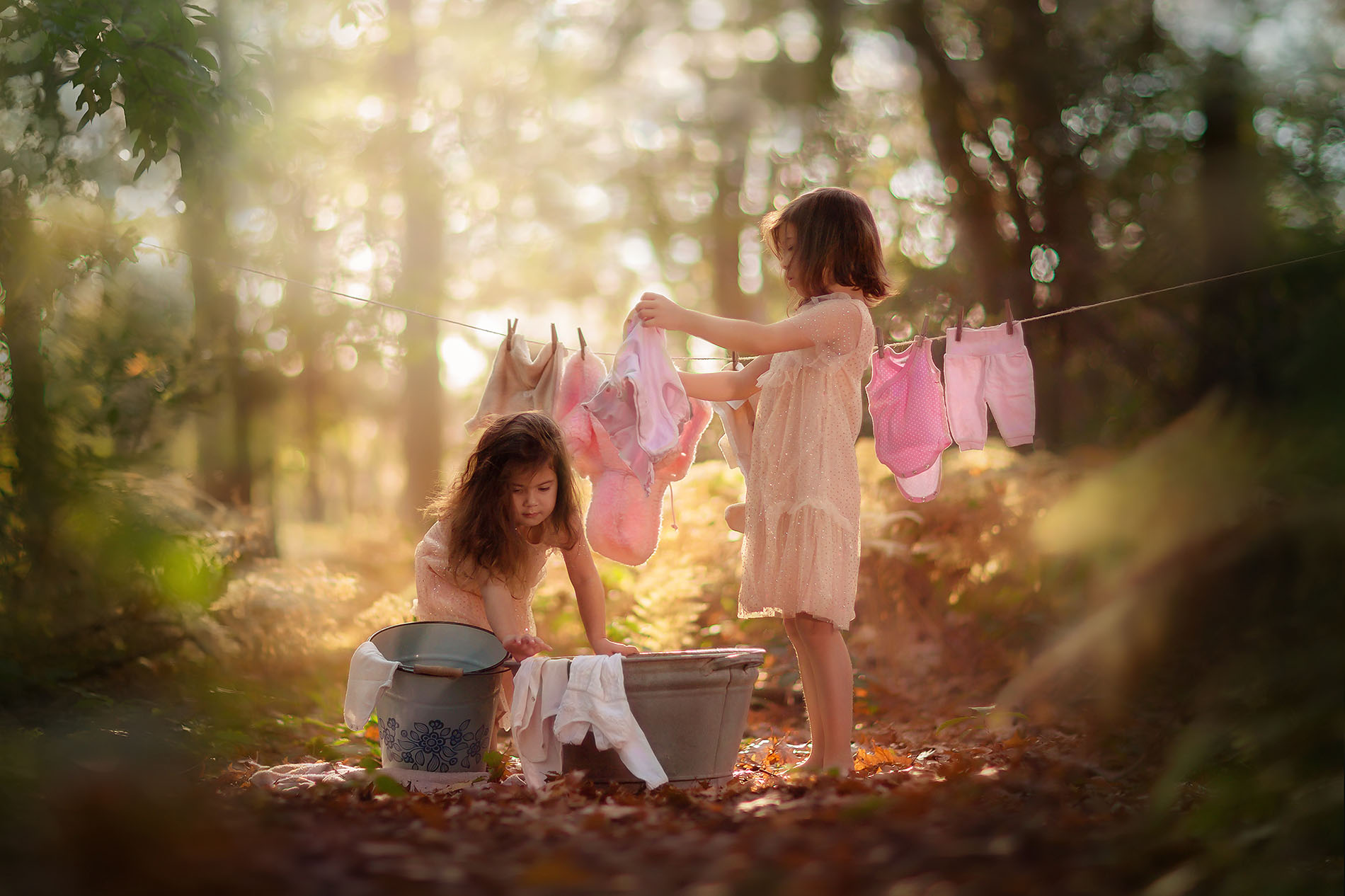 Canon fine art fall portrait of two little girls doing the laundry in an autumn forest just like in the old days by Willie Kers
