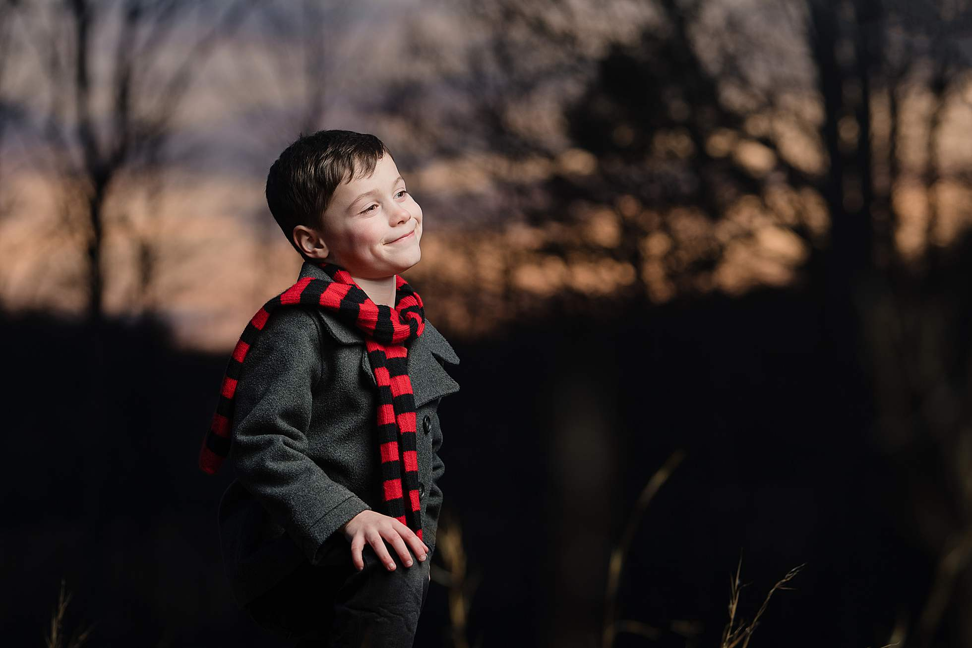 boy with red scarf at night
