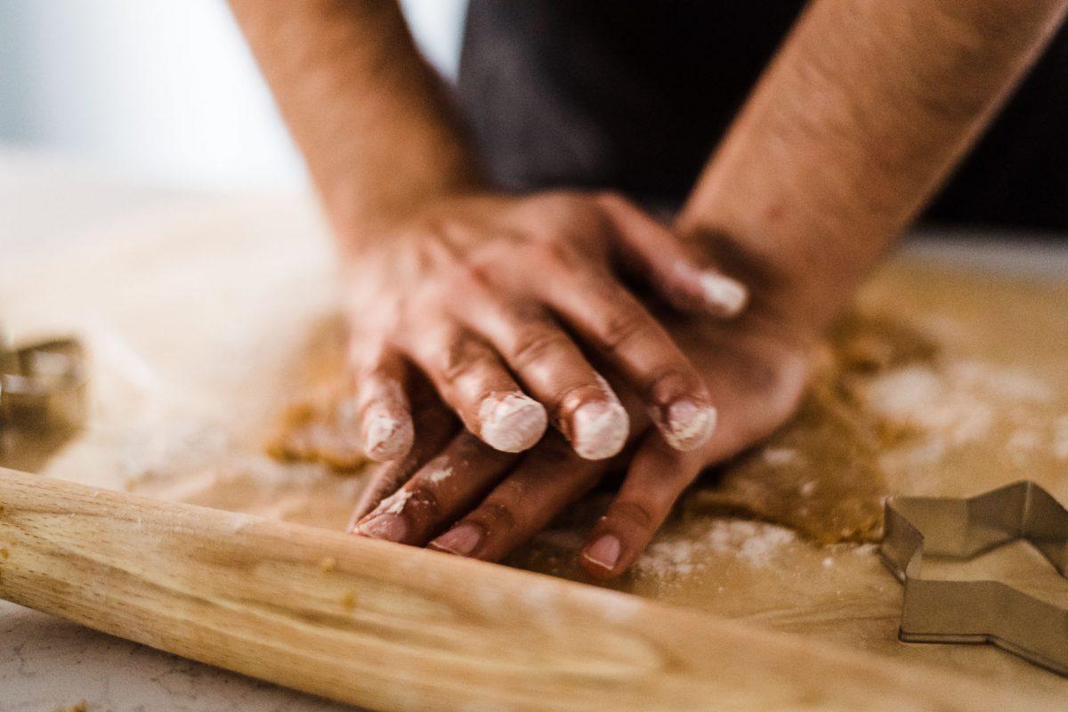 man baking cookie dough