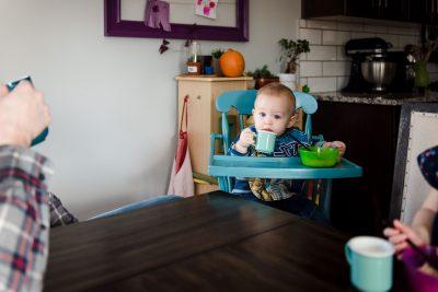 A little boy holding a tiny coffee mug by Edmonton Family Photographer Fiddle Leaf Photography
