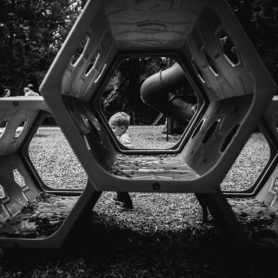 Young boy framed by shapes at playground