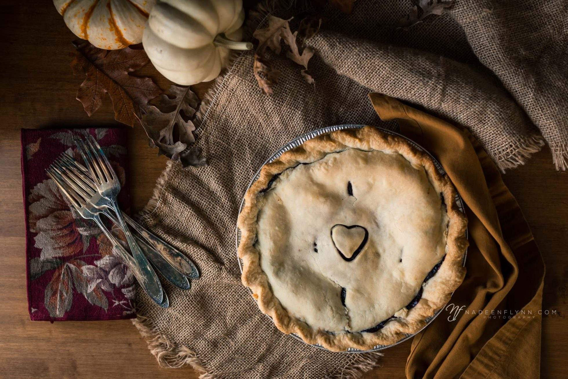 pie flat-lay with forks on burlap