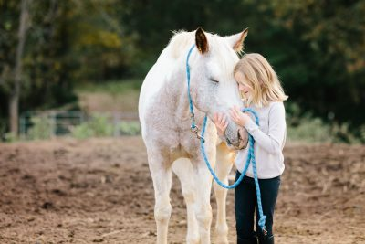 photograph of a girl and her horse