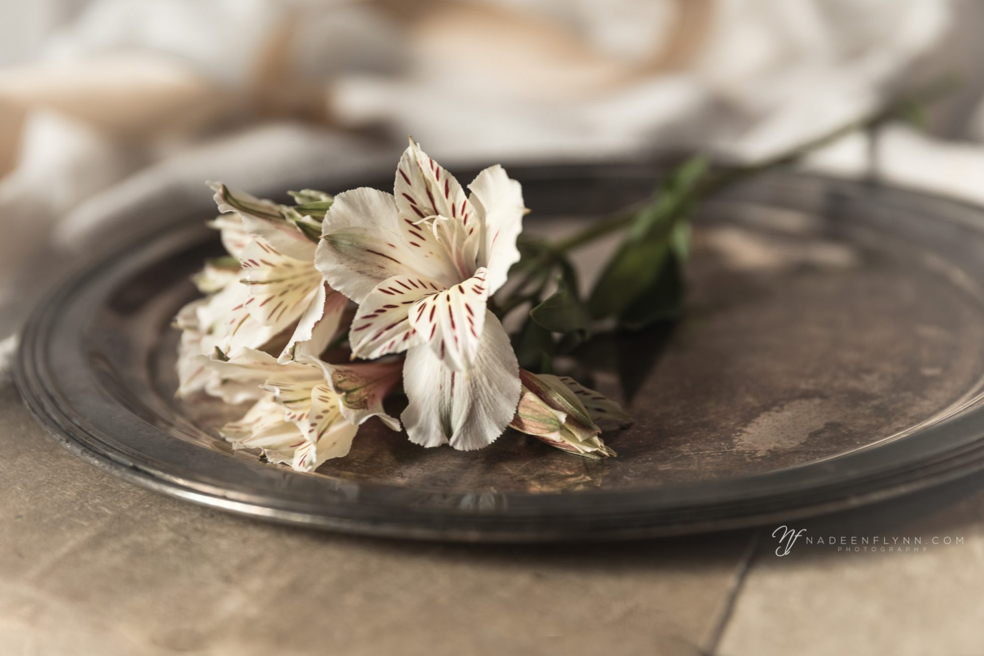 plated alstroemeria on silver platter