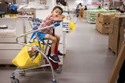 child sleeping in a shopping cart