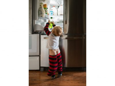 koren smith documentary photography baby boy getting into refrigerator and bare bottom