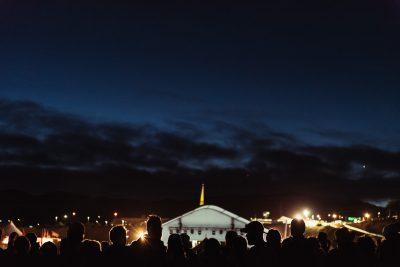 silhouettes of people against dark sky