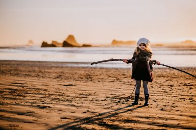 Maddie found the biggest adventure stick on the beach along the Pacific Coast in Washington.