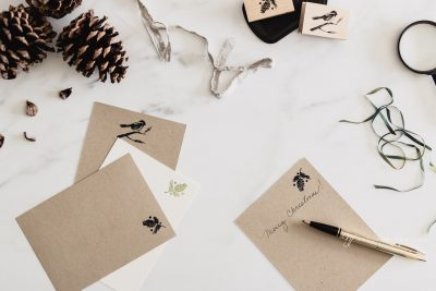 seasonal notes wit stamps and pine cone