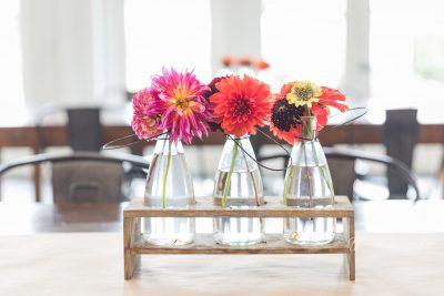 whimsical flowers in milk bottles