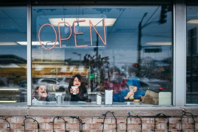 kids-at-window-in-donut-shop-open-sign_lindsayberos