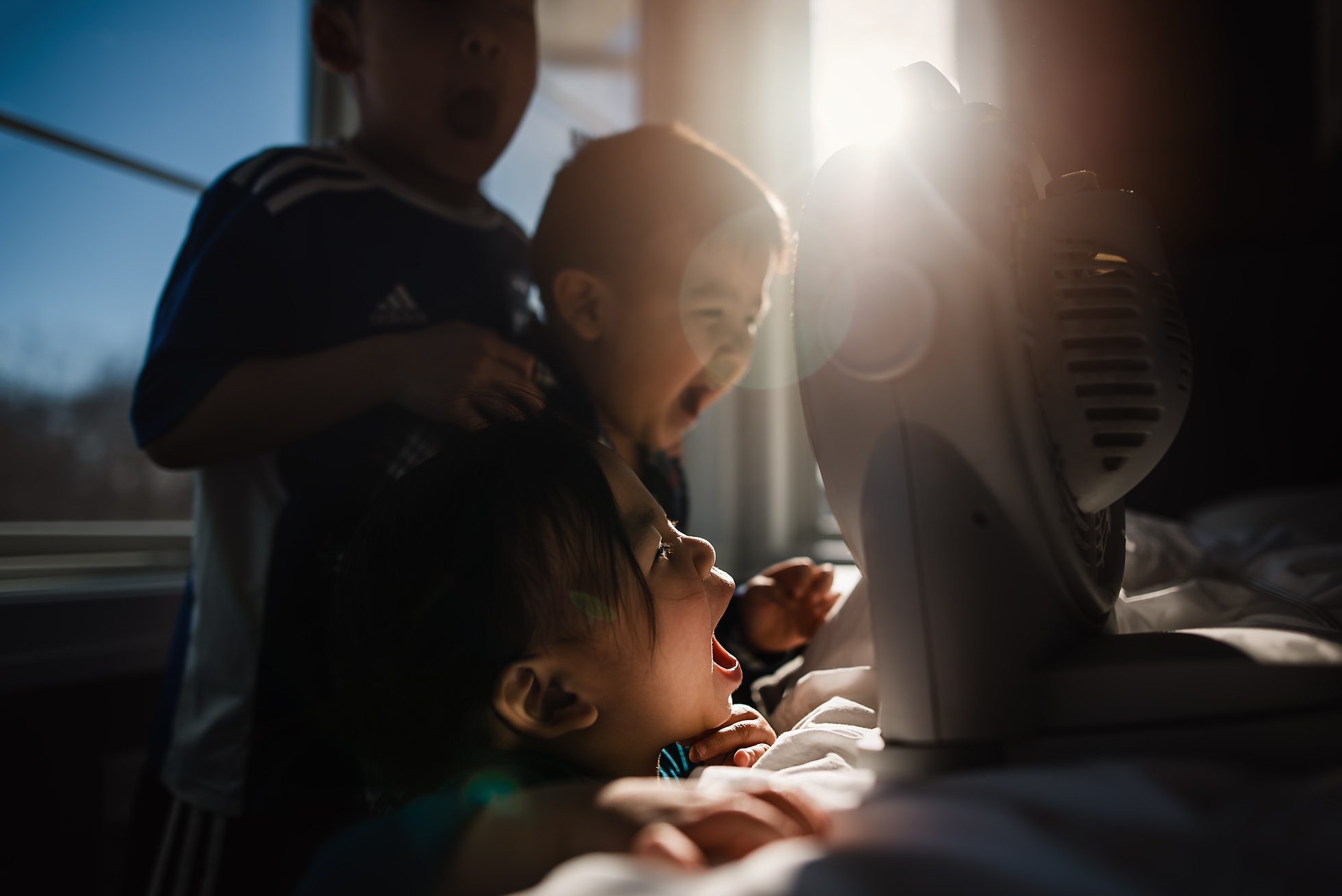 Siblings Yell into a Fan to Make Robot Voices, Documentary Photography by Thao Lai of donthaophotography.com