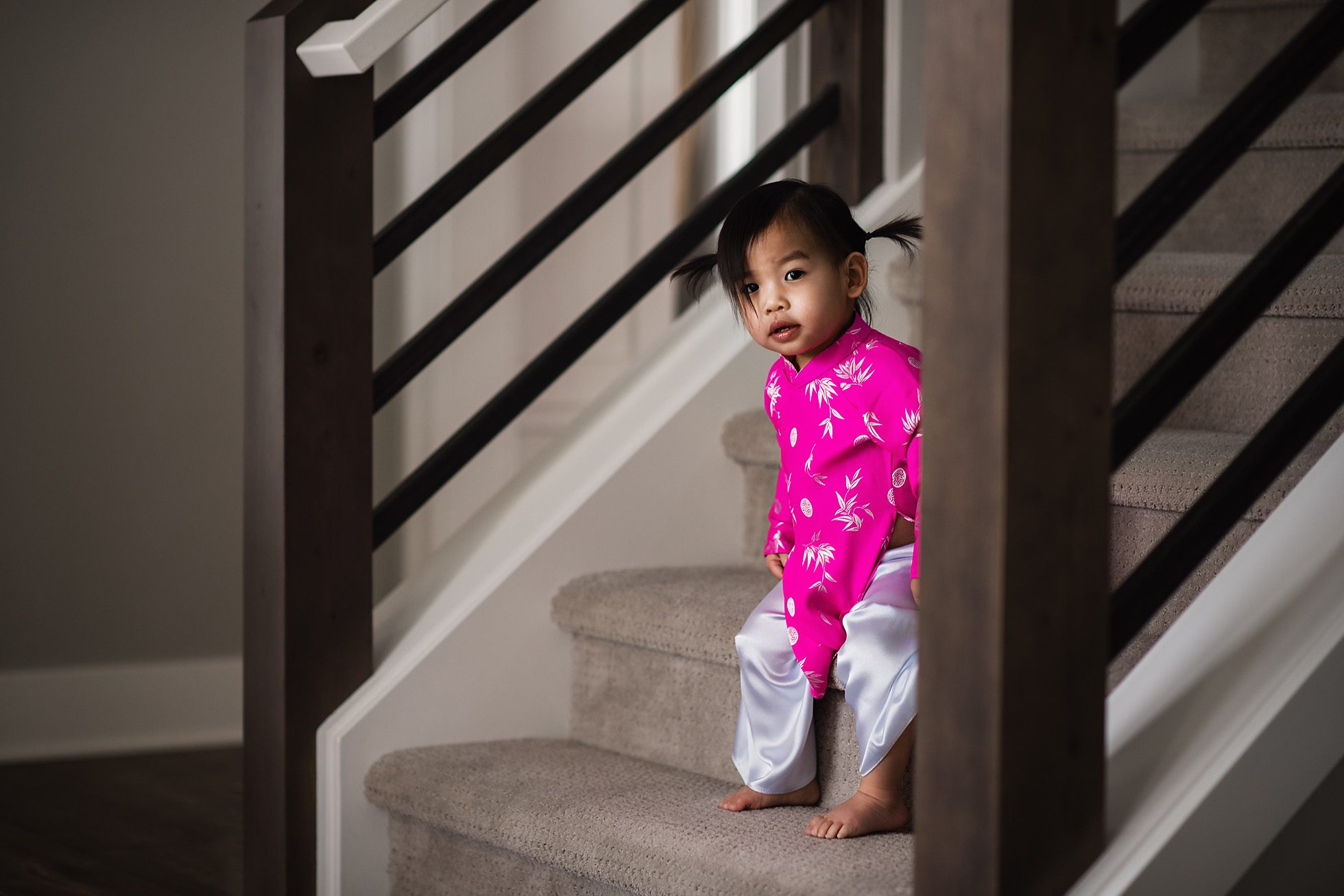 Little Toddler Vietnamese Girl in Ao Dai on the Stairs, Lifestyle photography by Thao Lai of donthaophotography.com