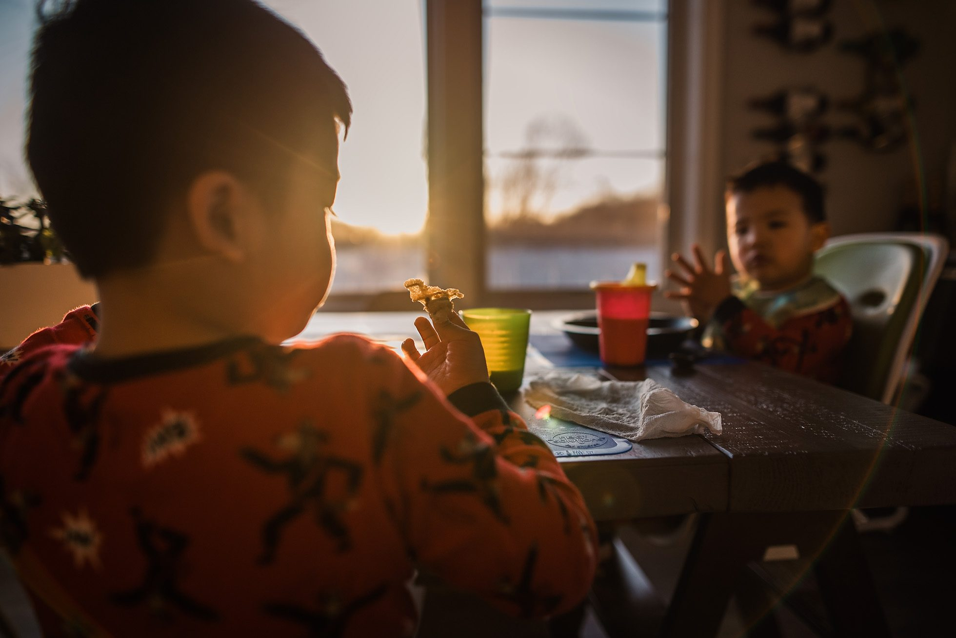 backlit, sunflare kids eating waffle for breakfast - documentary photography by Thao Lai of donthaophotography.com