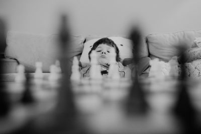 child playing chess Boston family photographer
