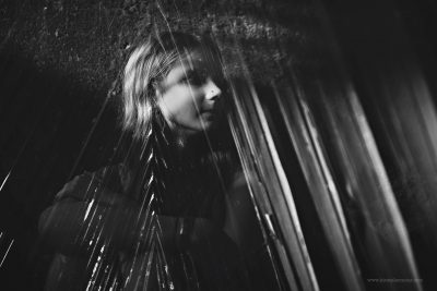 A double exposure by Kirsty larmour of a girl in black and white overlaid by a palm leaf giving the impression of a plait in her hair