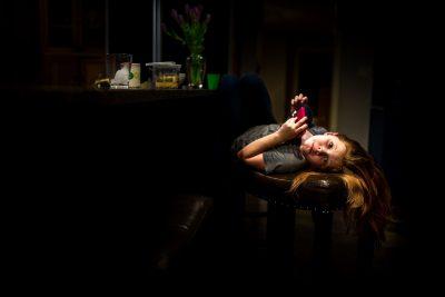 rebecca_wyatt_girl_upside_down_on_stool_with_phone-1